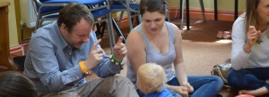 parents and baby doing sign language and music