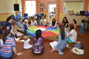 parents, babies and toddlers singing and signing and parachute games