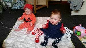 babies doing sign language at Halloween